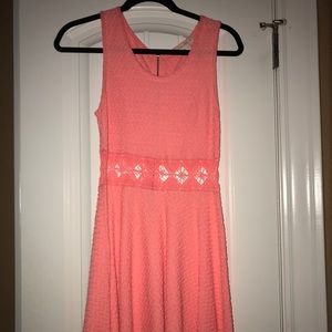 Pink summer dress with cut outs around middle